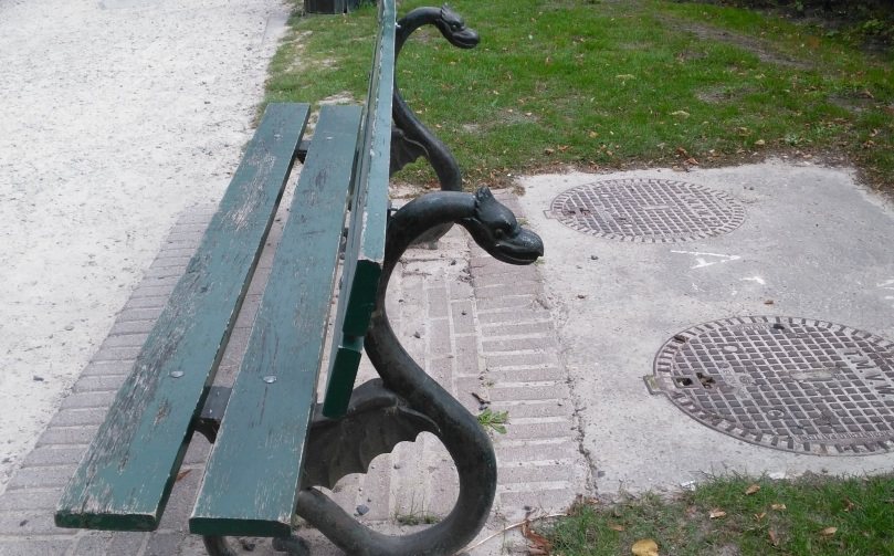 Bruges bench with dragon supports