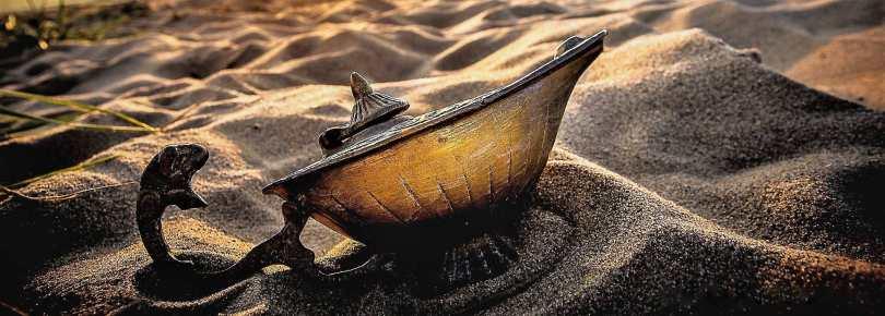 A magic lamp on sand.